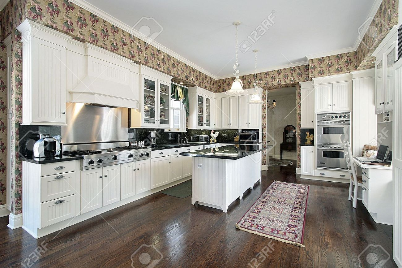 Kitchen Desk Kitchen With White Cabinets And Desk Area Stock Photo Picture And