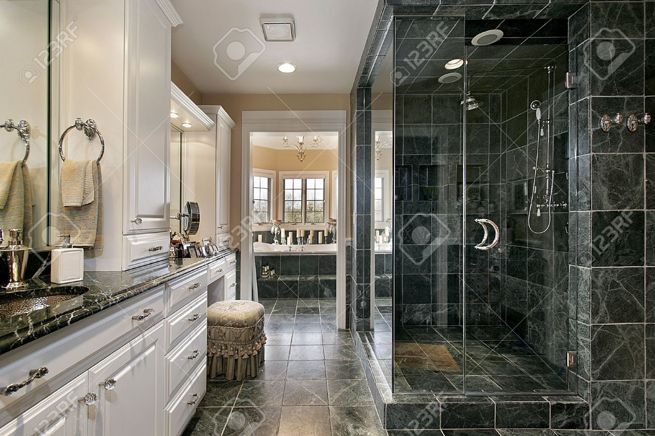 Master Bath In Luxury Home With Black Glass Shower Stock