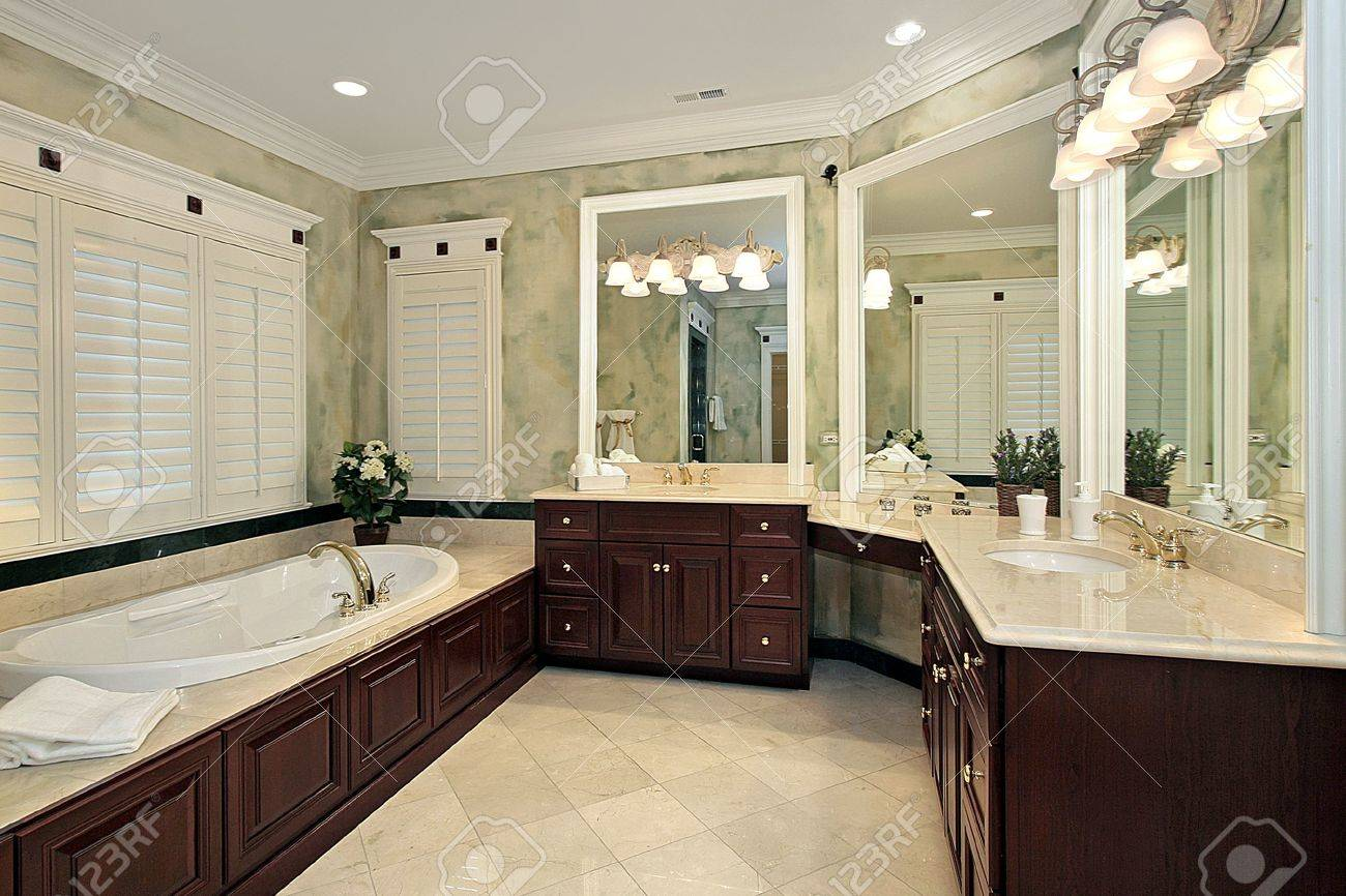 Luxury master bathroom - Luxury Master Bath With Cherry Wood Cabinetry Stock Photo 6732776