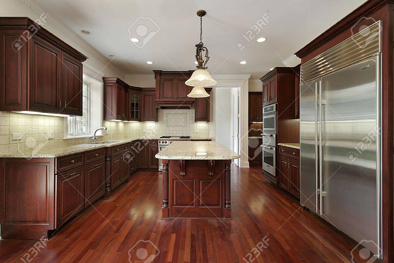 Kitchen Cherry Cabinets Kitchen In New Construction House With Cherry Cabinets Stock Photo