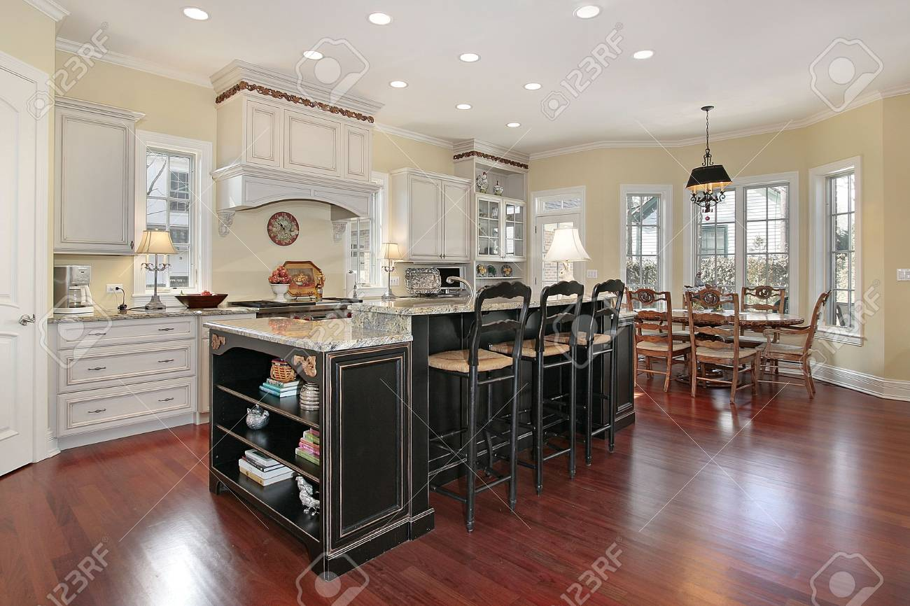 luxury kitchen with marble island and cherry wood floors stock photo