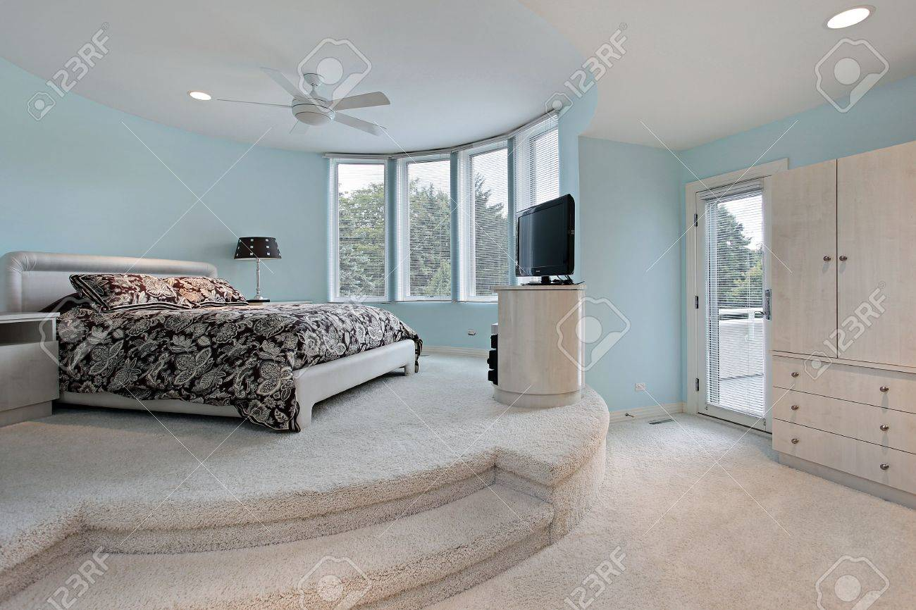 Bedroom in upscale home with step up sleeping area Stock Photo - 6761120