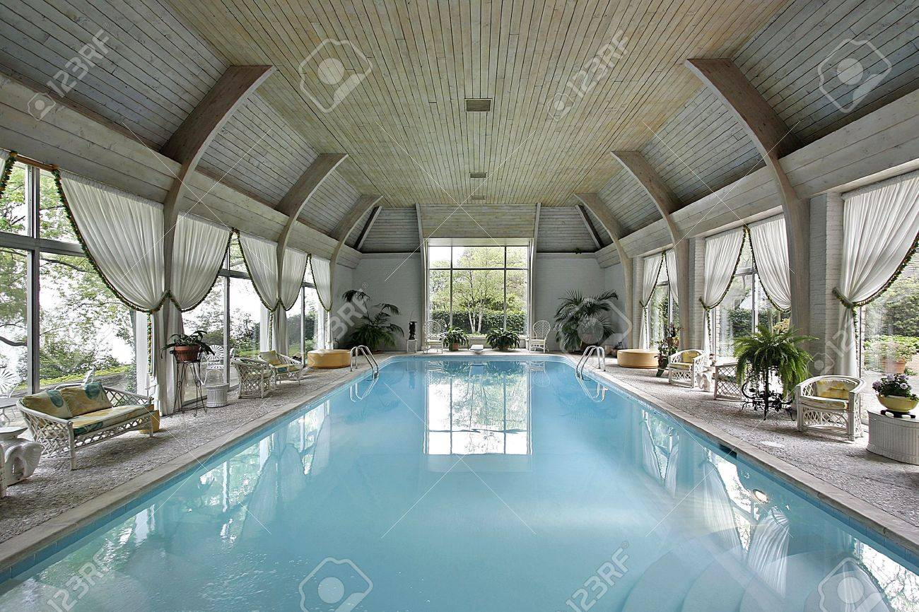 Large indoor swimming pool in luxury home - 6732485
