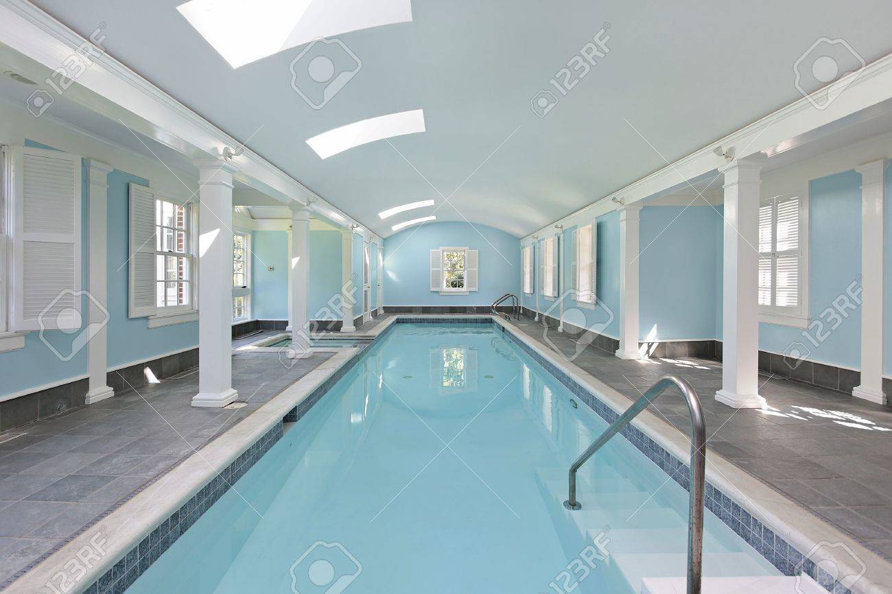 long indoor swimming pool in luxury home stock photo picture and