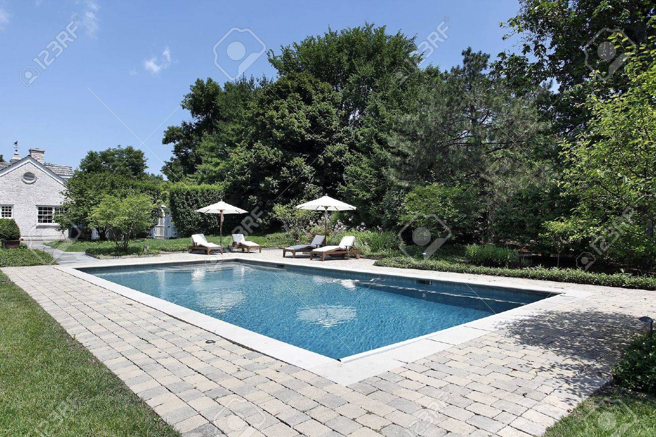 Swimming Pool Of Luxury Home With Deck Chairs Stock Photo, Picture ...
