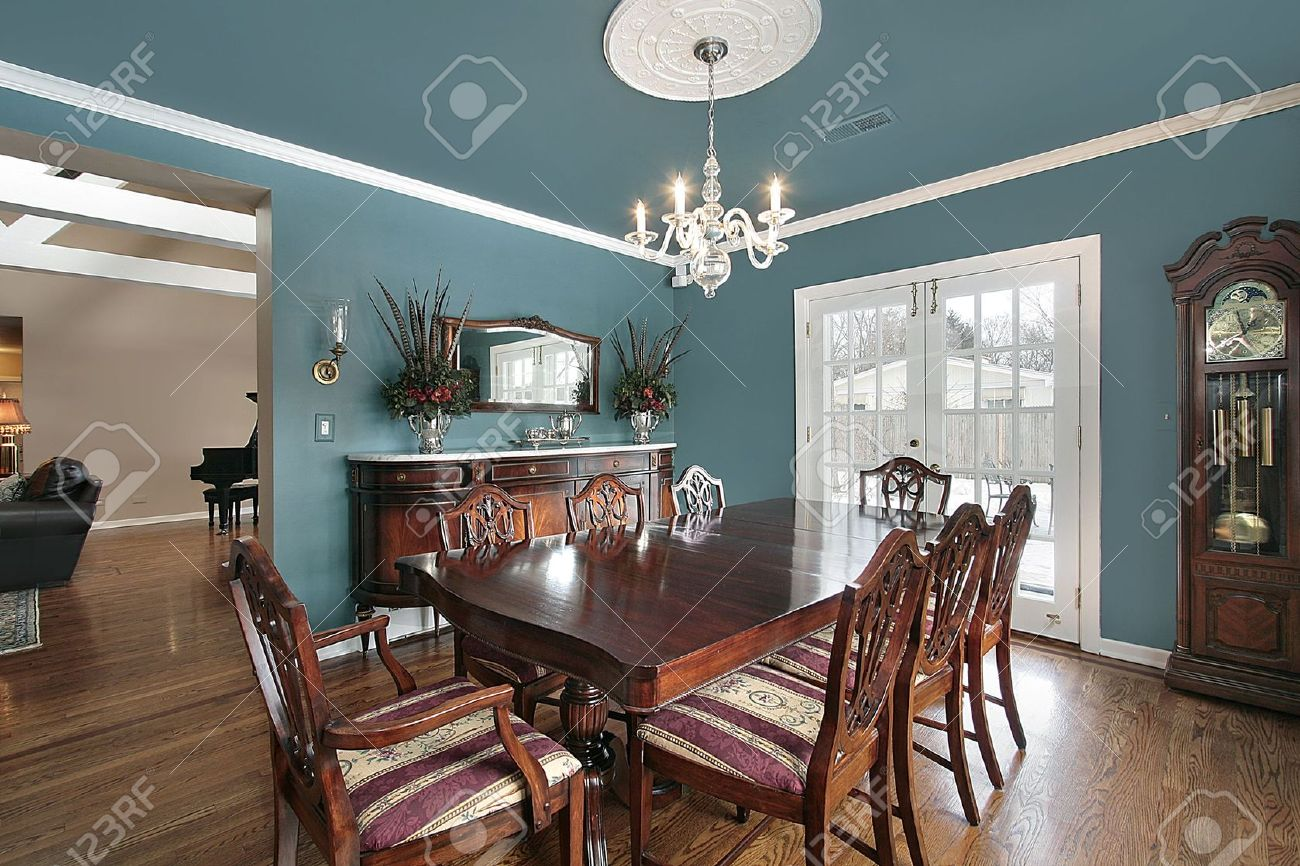 elegant dining room with slate blue walls stock photo, picture and