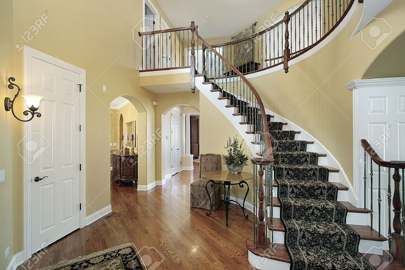 Luxury Home Foyer : Foyer in luxury home with curved staircase stock photo picture