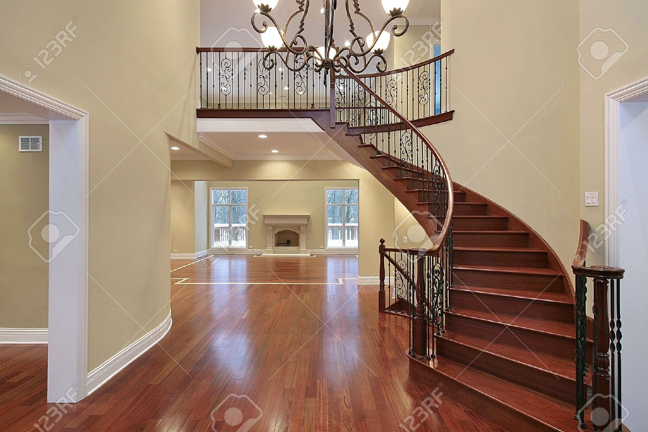 Beau Cherry Wood Foyer With Balcony And Curved Staircase Stock Photo   6732822