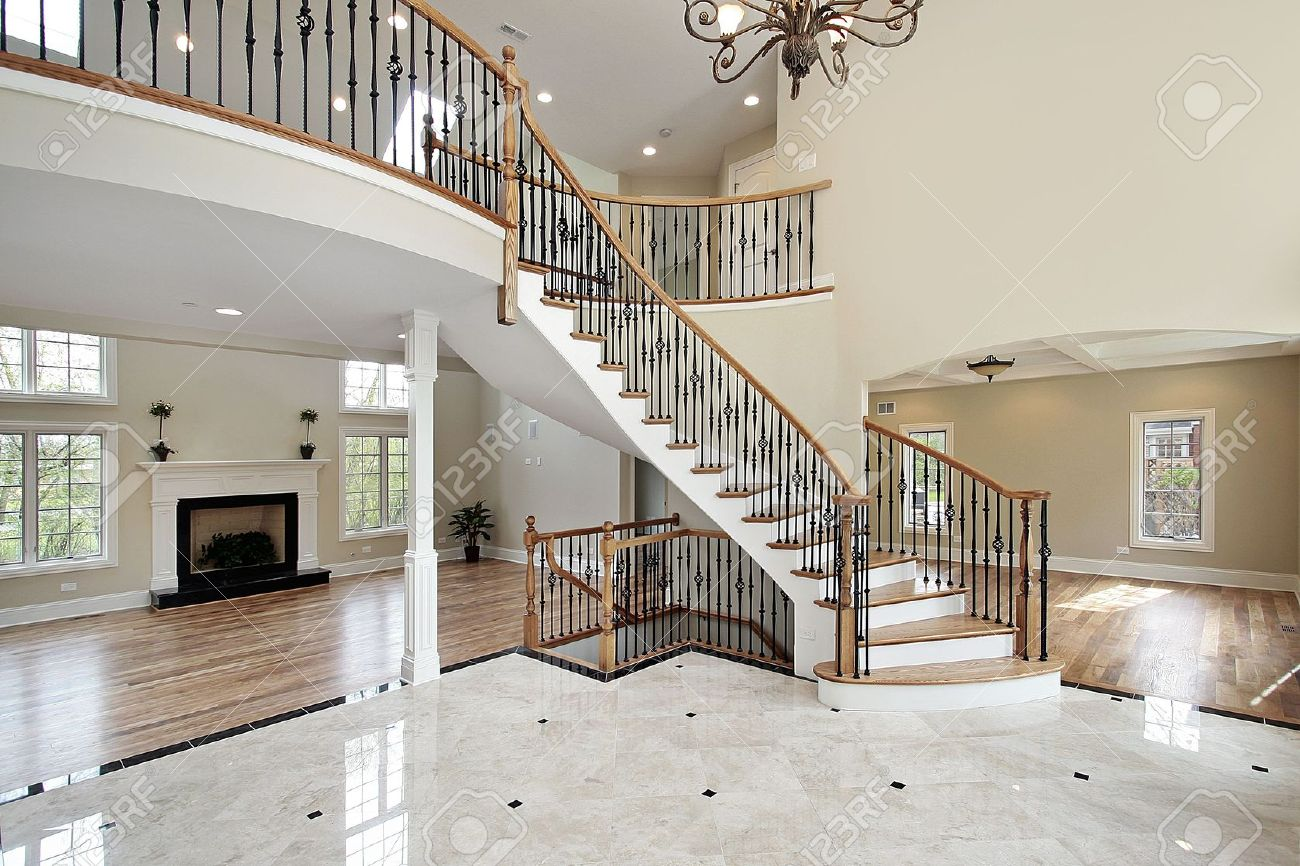 Luxury Homes Foyer foyer with curved staircase in luxury home stock photo, picture