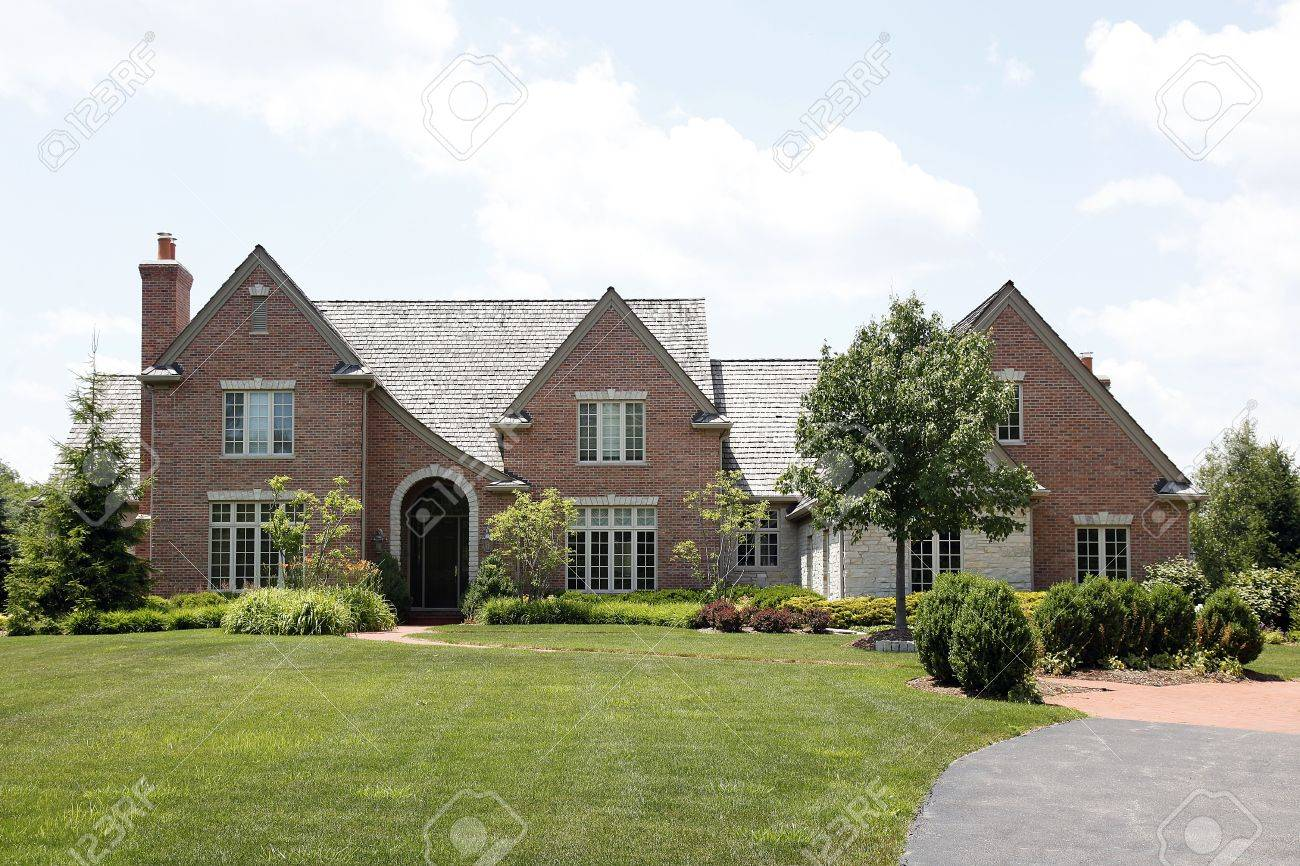 Brick home in suburbs with cedar shake roof Stock Photo - 6761269