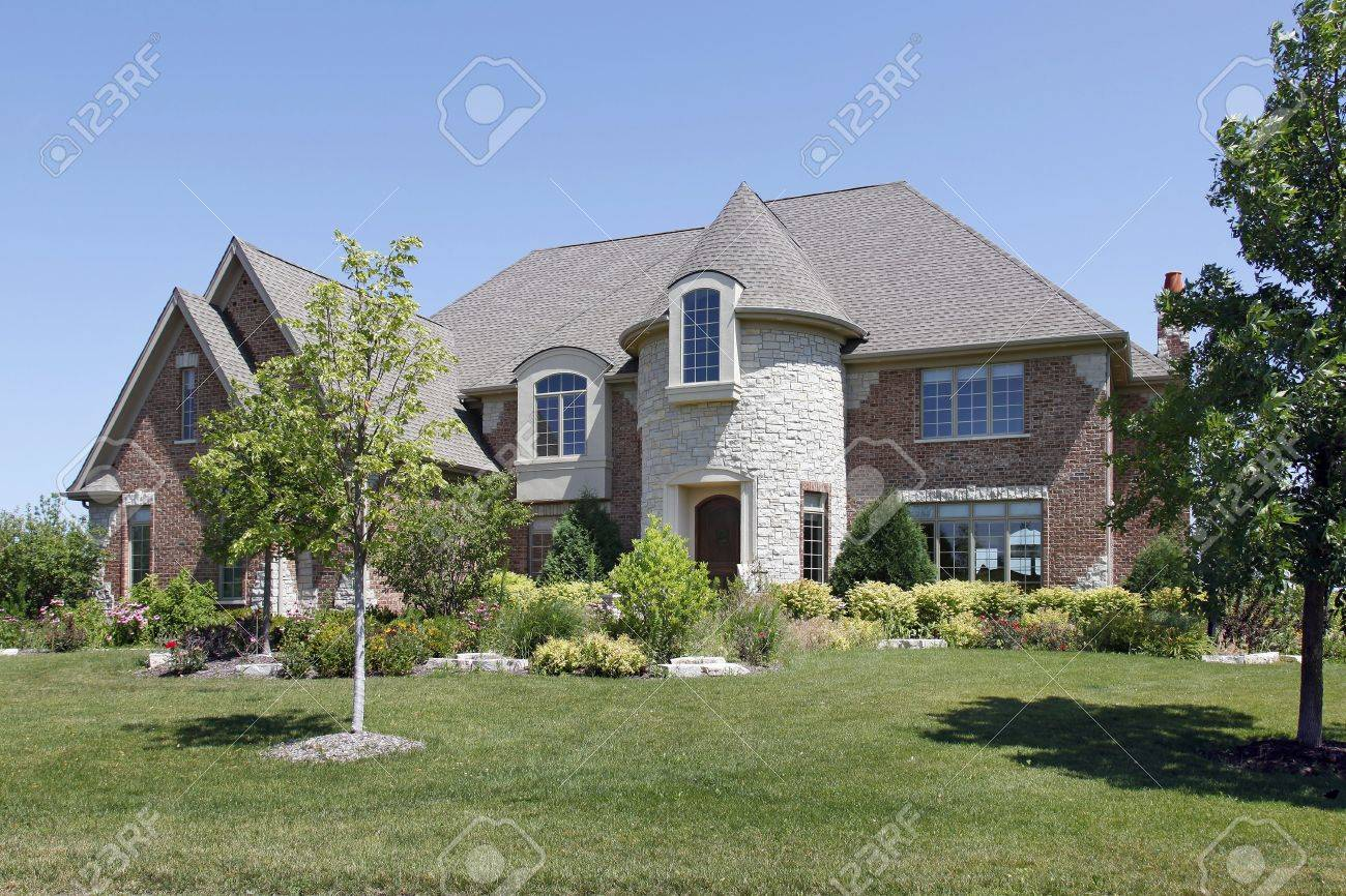 Luxury brick home in suburbs with stone turret Stock Photo - 6761058