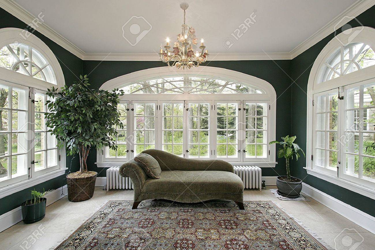 Sunroom in luxury home with sofa and wall of windows Stock Photo - 6733058