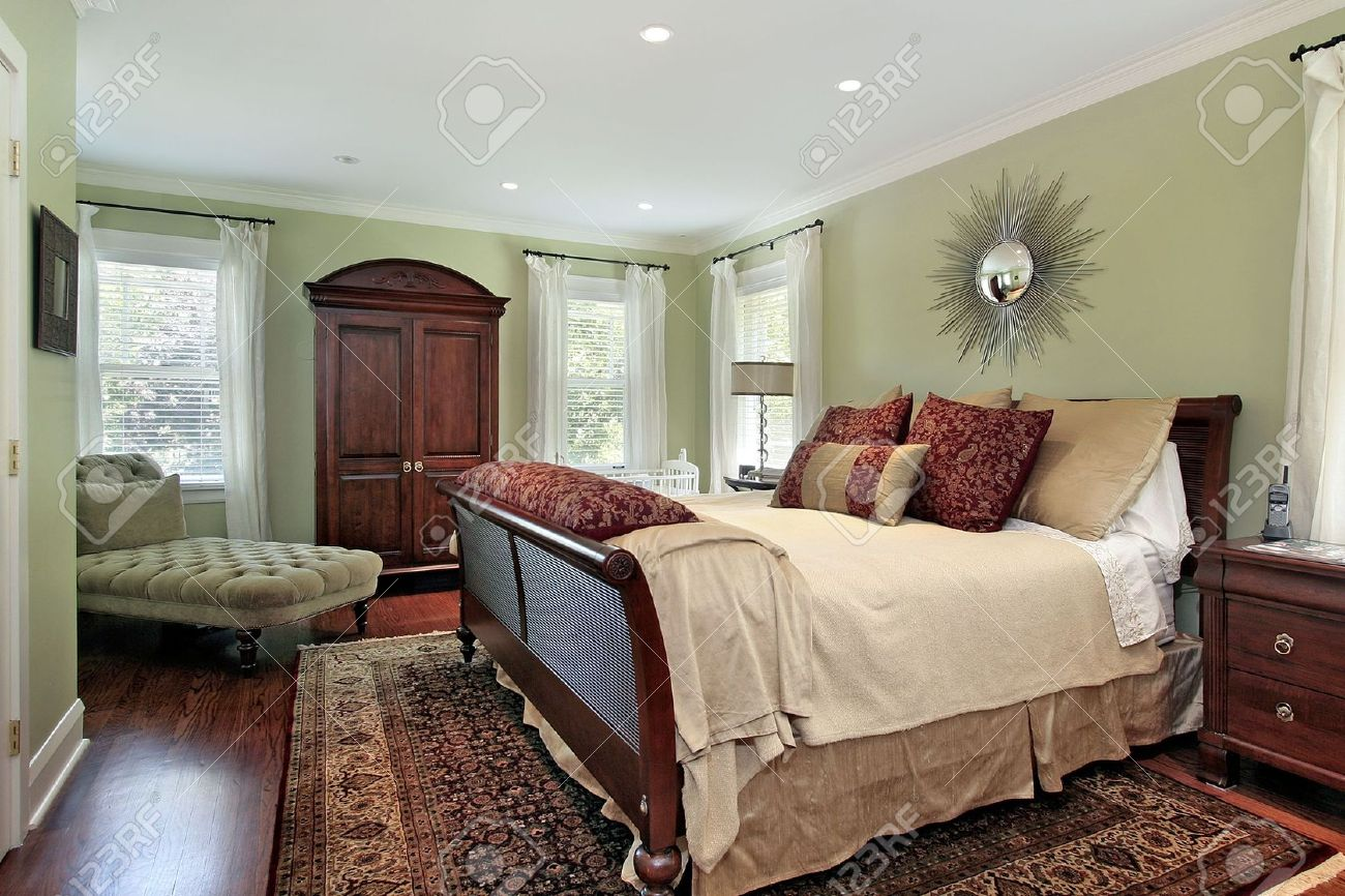Master bedroom in suburban home with green walls Stock Photo - 6732402