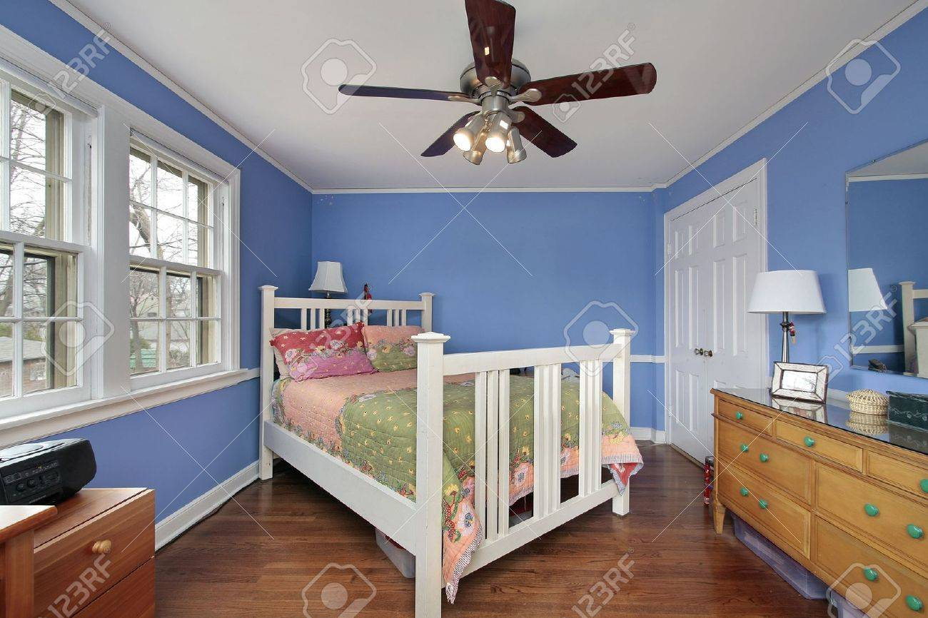 Bedroom in suburban home with blue walls Stock Photo - 6733518