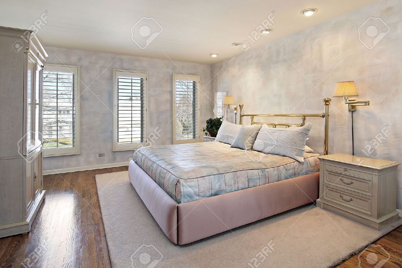 Master Bedroom In Suburban Home With Wood Floors Stock Photo ...