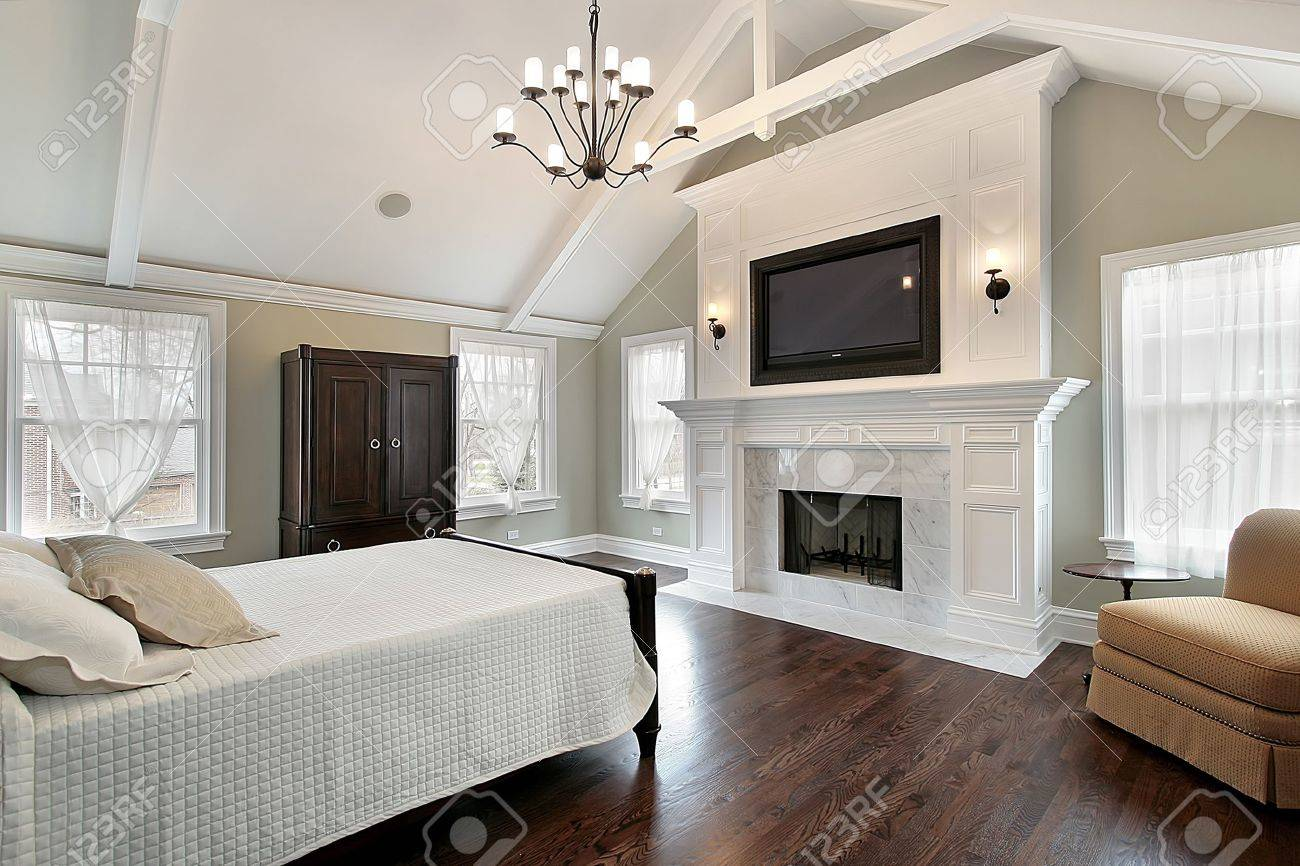 Master Bedroom In Luxury Home With Marble Fireplace Stock Photo   6732671