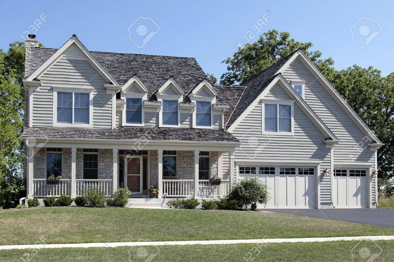 Suburban home with porch and cedar roof Stock Photo - 6733384
