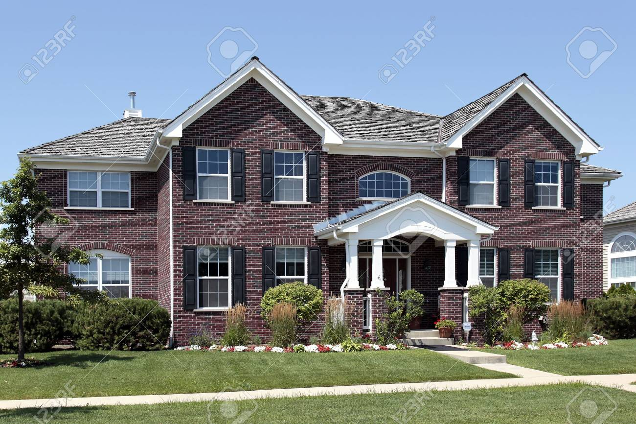 Large brick home in suburbs with arched entry Stock Photo - 6761201