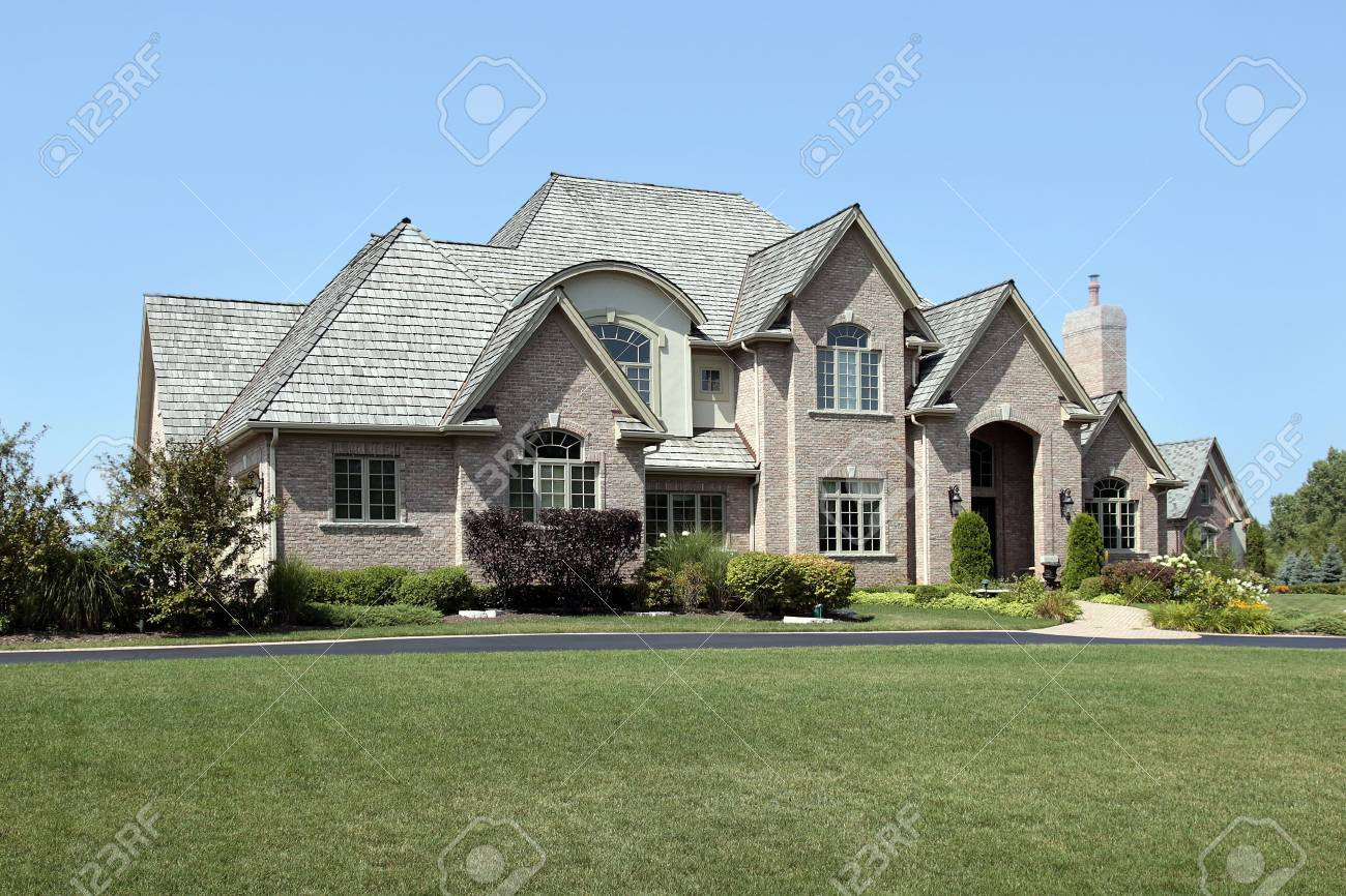 Large brick home in suburbs with arched entry Stock Photo - 6761262