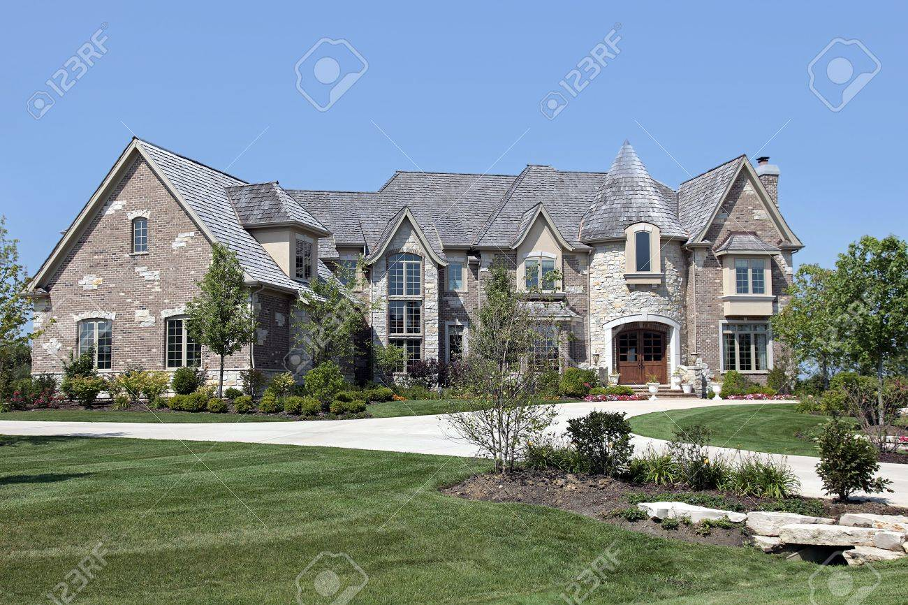 Luxury brick and stone home with turret Stock Photo - 6761279