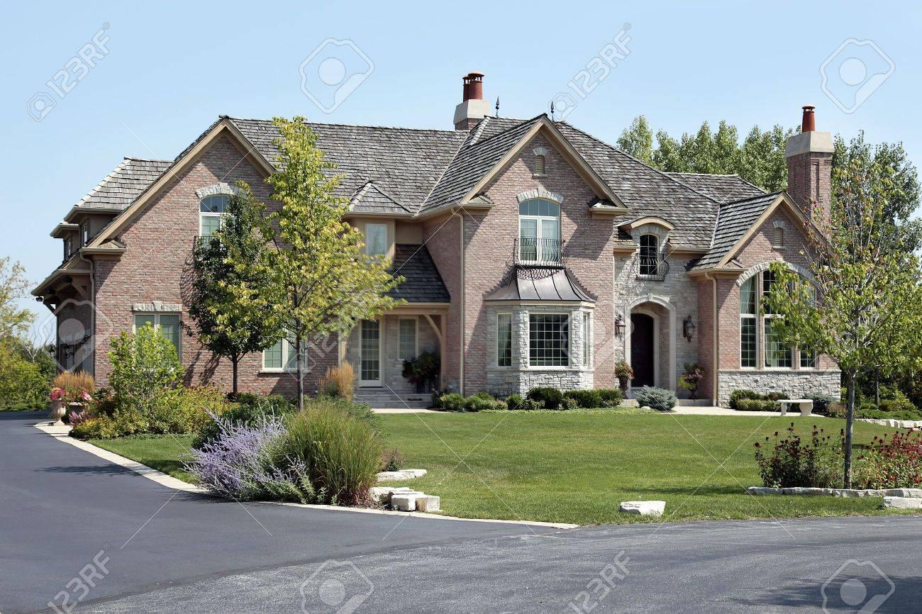 Luxury brick home in suburbs with cedar shake roof Stock Photo - 6761234