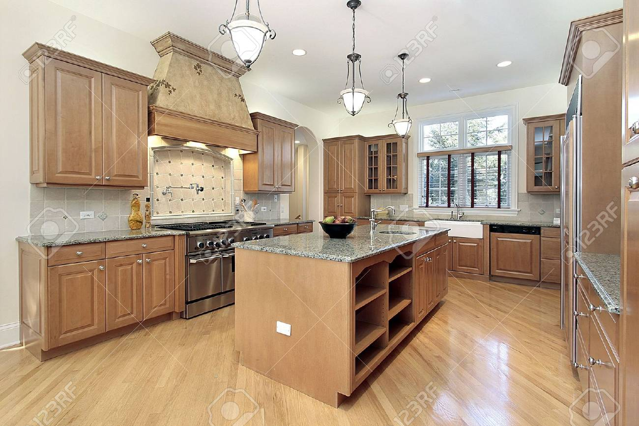 Kitchen in new construction home with oak cabinetry Stock Photo - 6732469