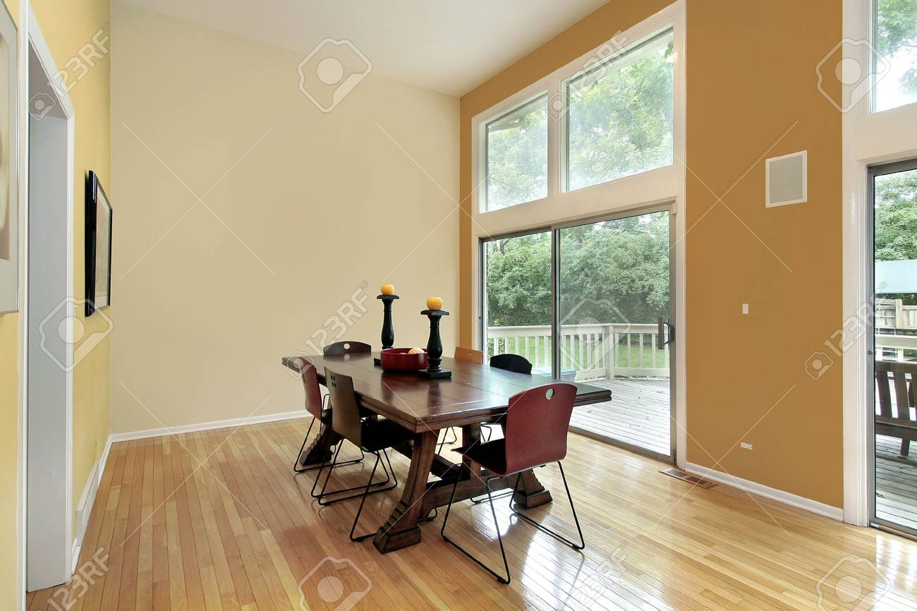 Eating area with two story windows and orange wall Stock Photo - 6732710