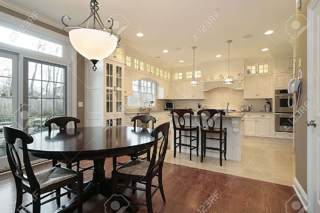 Kitchen Island Eating Area kitchen and eating area in luxury home stock photo, picture and