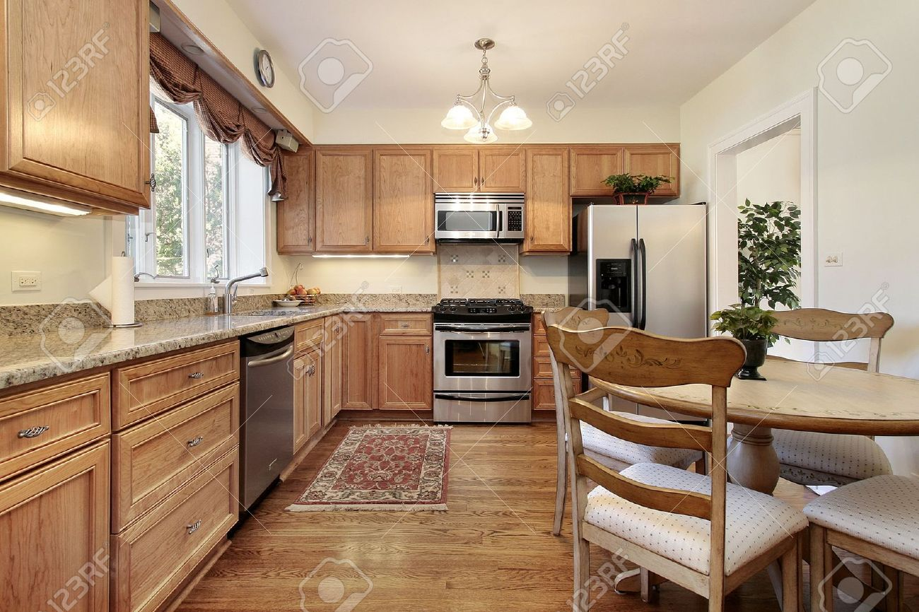 Kitchen And Table In Suburban Home With Wood Paneling Stock Photo   6733108