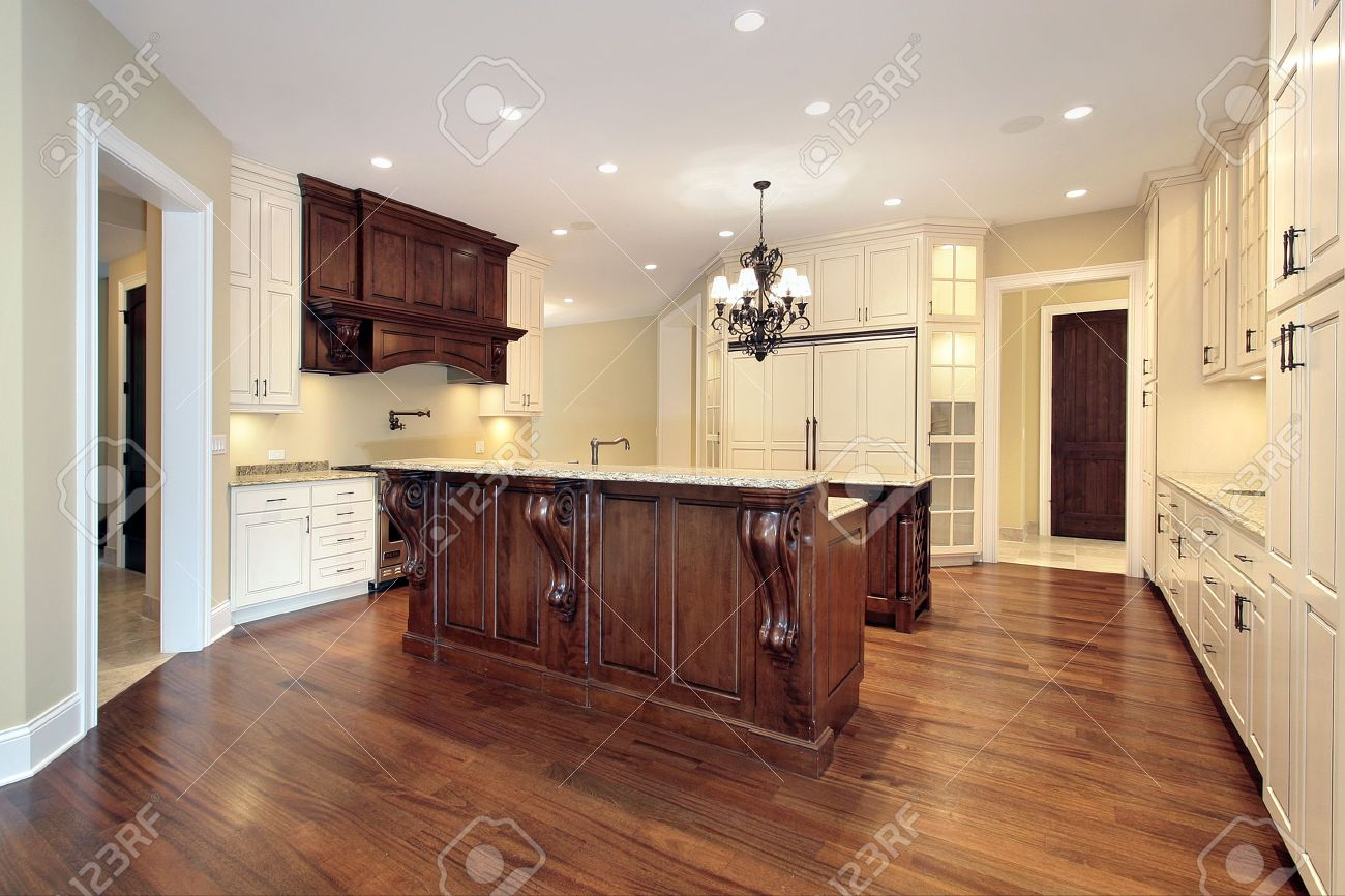 Kitchen In Luxury Home With Wood Paneling And Marble Island Stock Photo    6733435