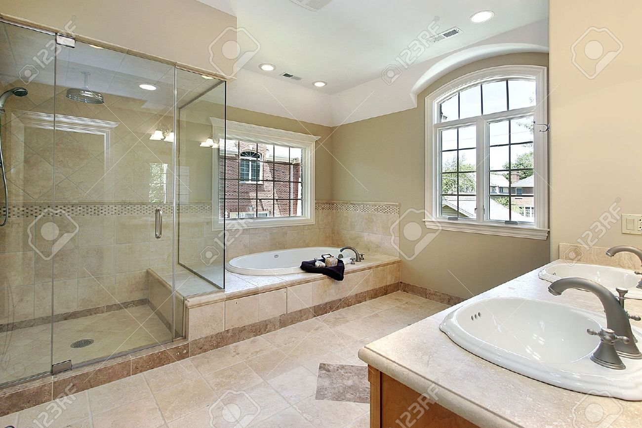 Master Bath With Glass Shower And Large Tub Stock Photo   6732867