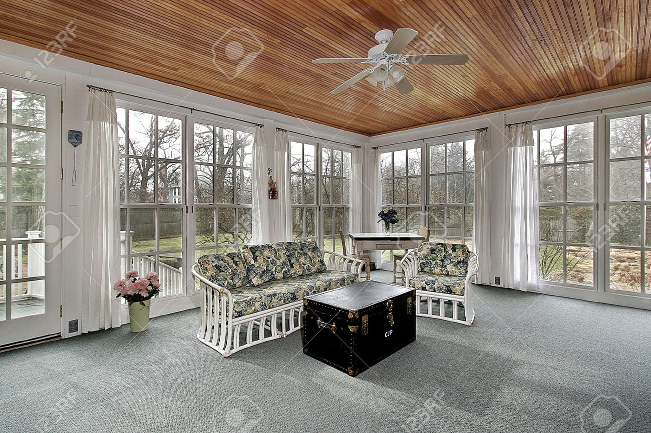 Large porch in suburban home with wood paneled ceililng Stock Photo - 6738153
