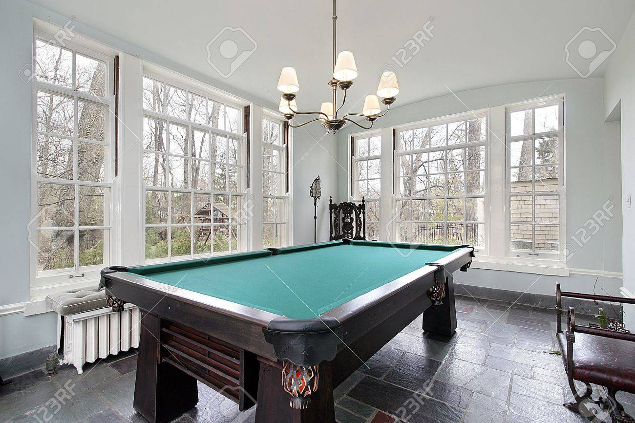 Pool Table In Sunroom Of Luxury Home Stock Photo   6738178