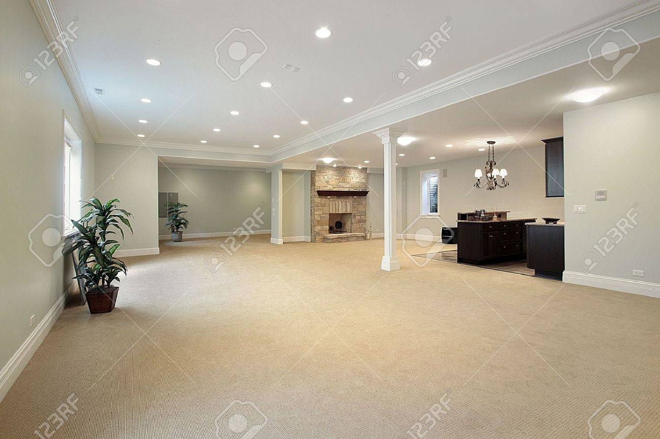 basement in luxury home with stone fireplace stock photo picture
