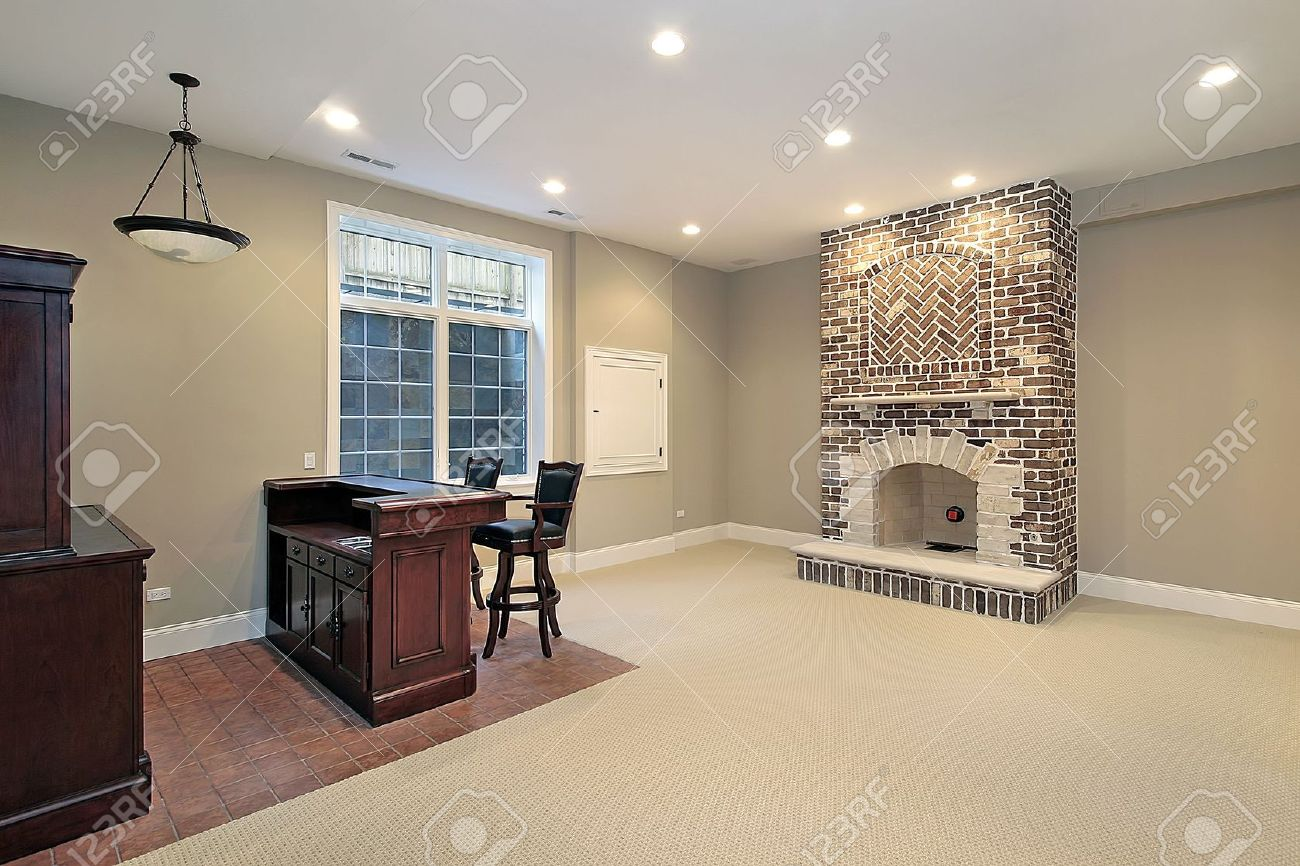 basement in new construction home with brick fireplace stock photo