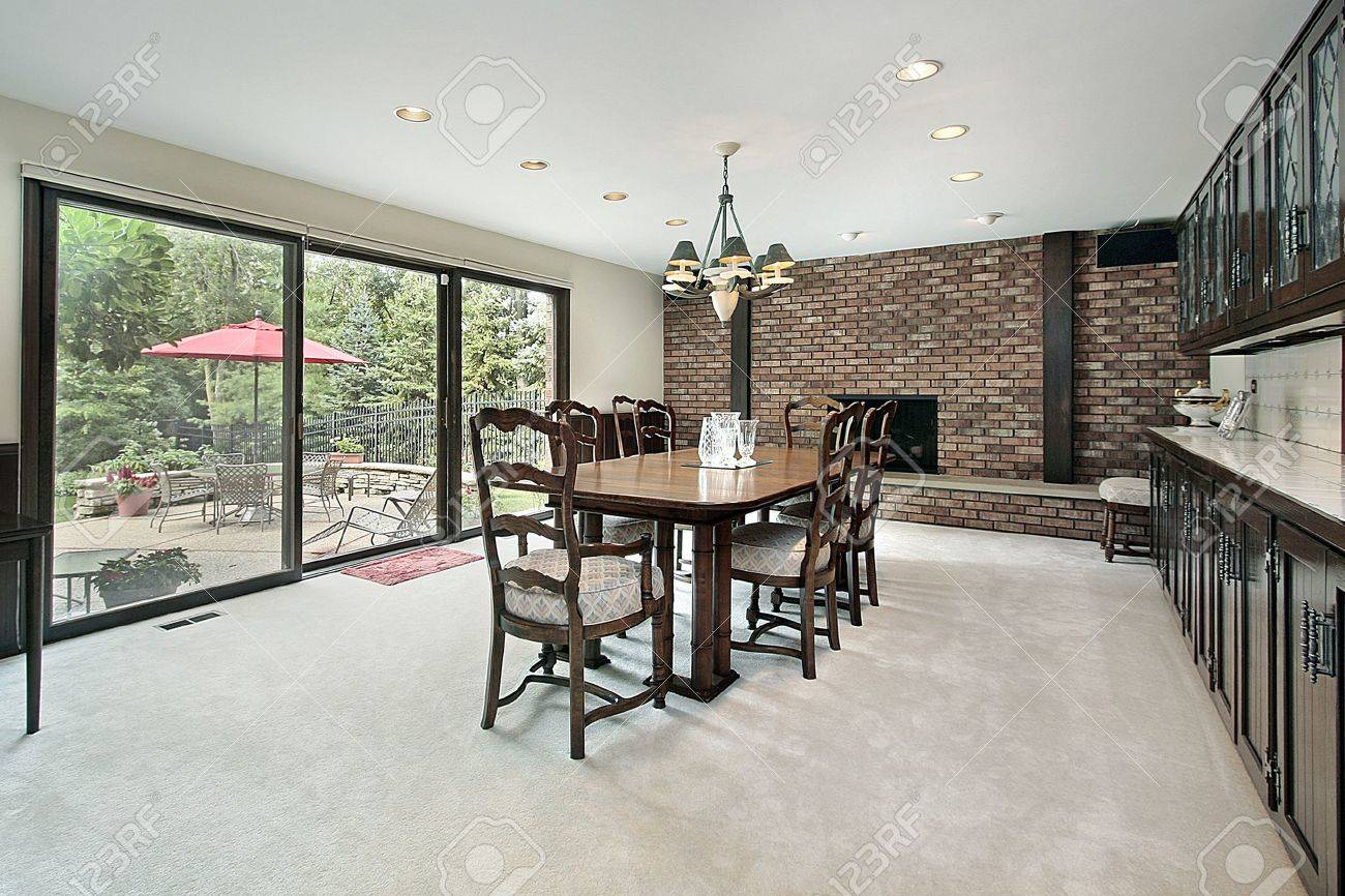 Dining Room With Brick Fireplace And View To Patio Banque Dimages