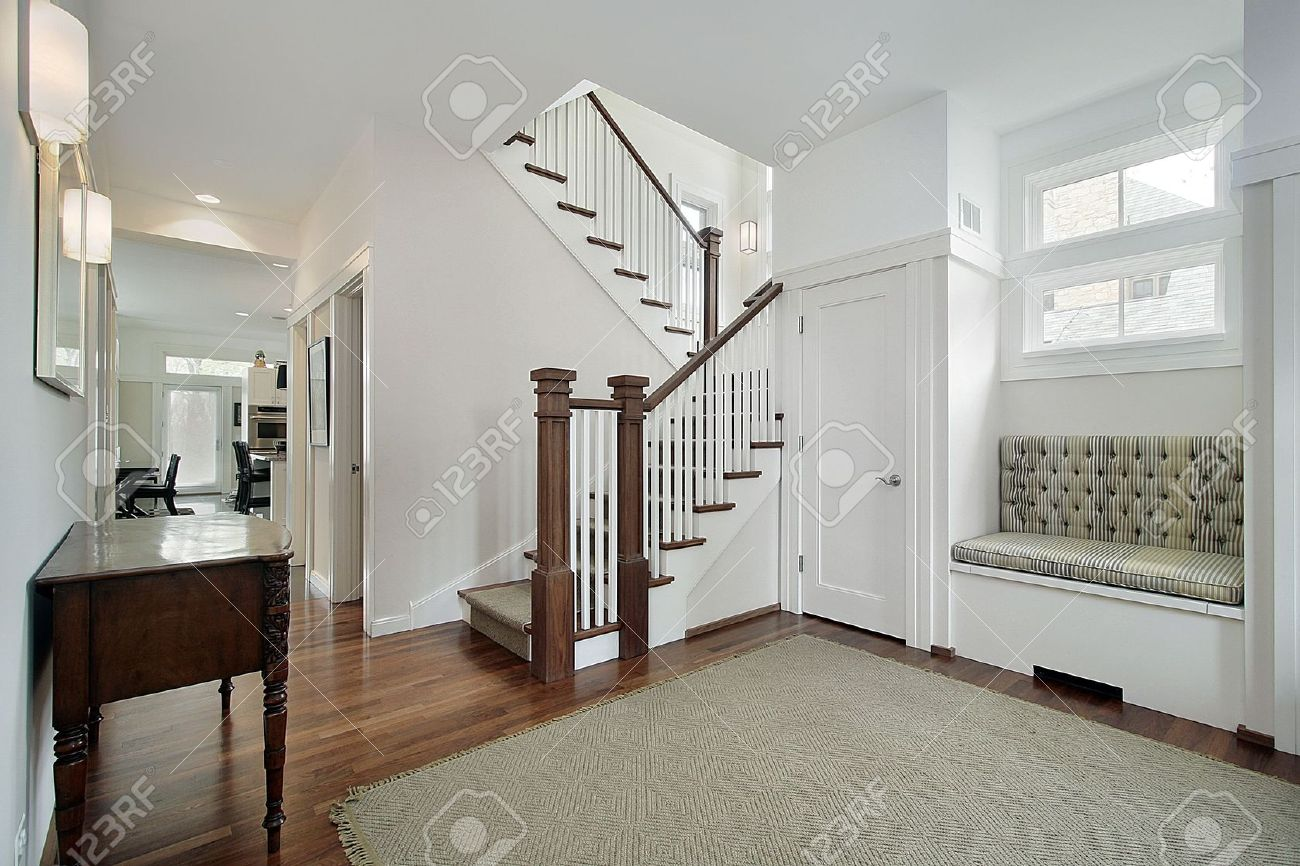 Foyer In Older Suburban Home With White Stair Railing Stock Photo ...