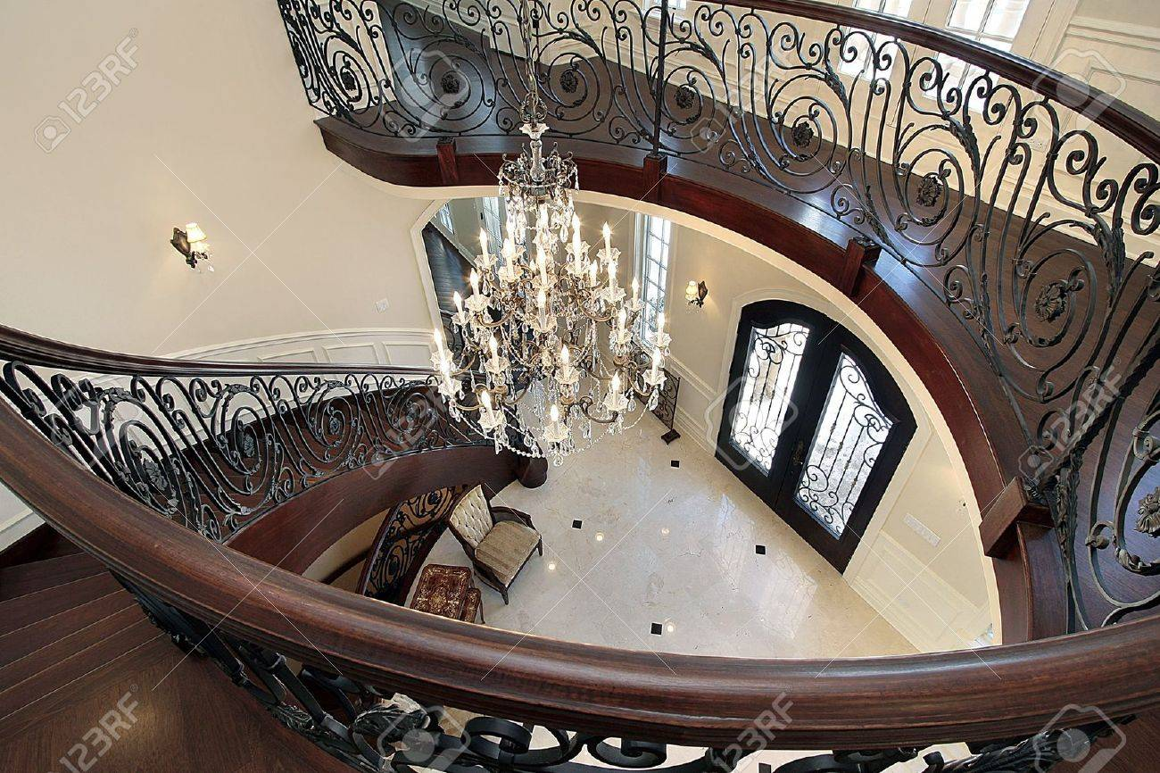 Curved stairway leading down into foyer in luxury home Stock Photo - 6738550