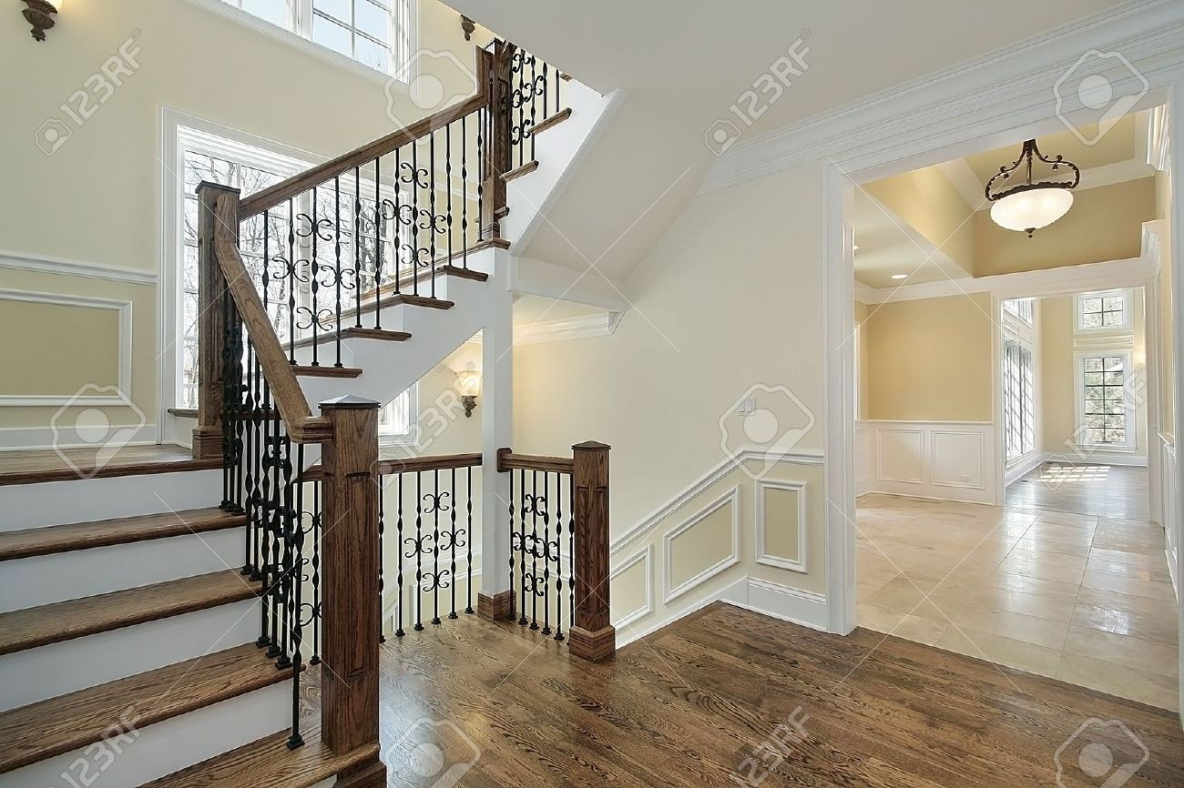 Foyer In New Construction Home With Wood Staircase Stock Photo   6738988