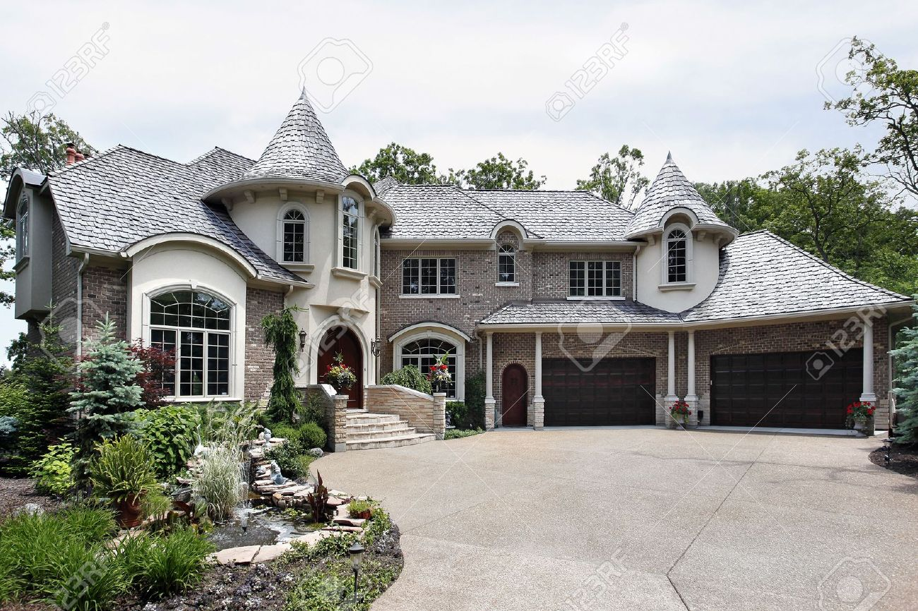 Front view of luxury brick home with two turrets Stock Photo - 6739529