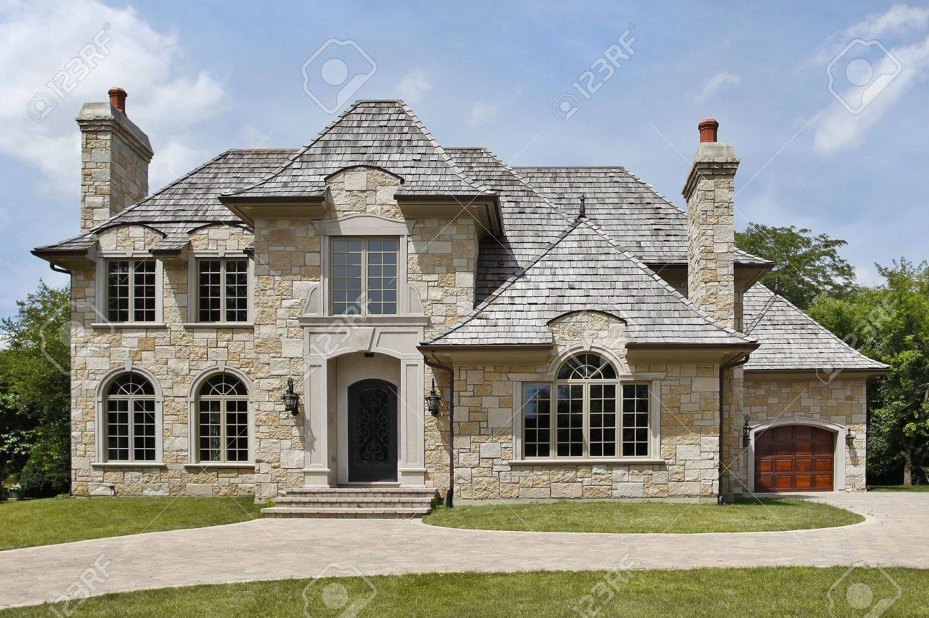 luxury home exterior luxury stone home with arched entry way stock photo