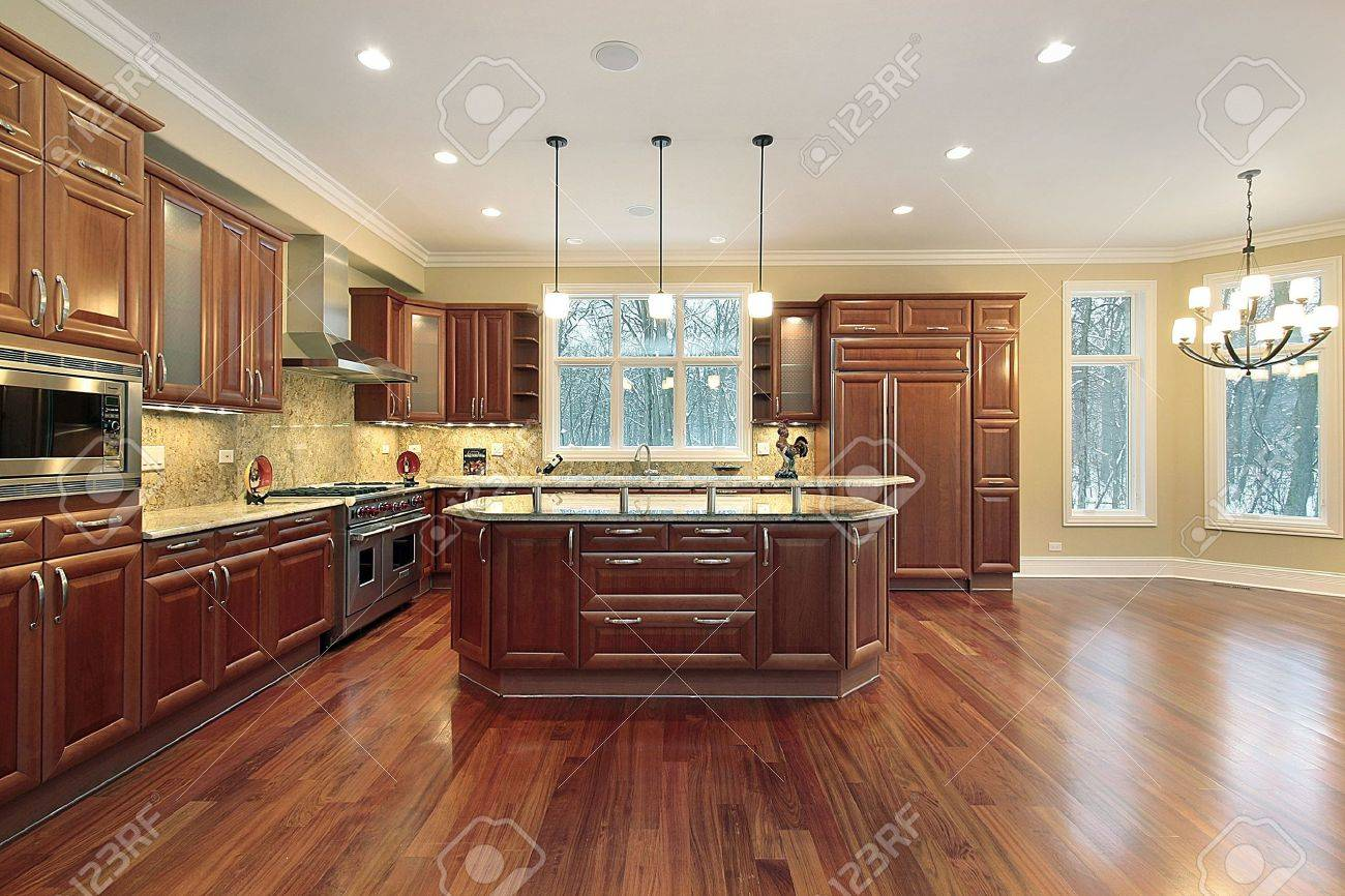 Kitchen Eating Area Kitchen And Eating Area With Island In Luxury Home Stock Photo