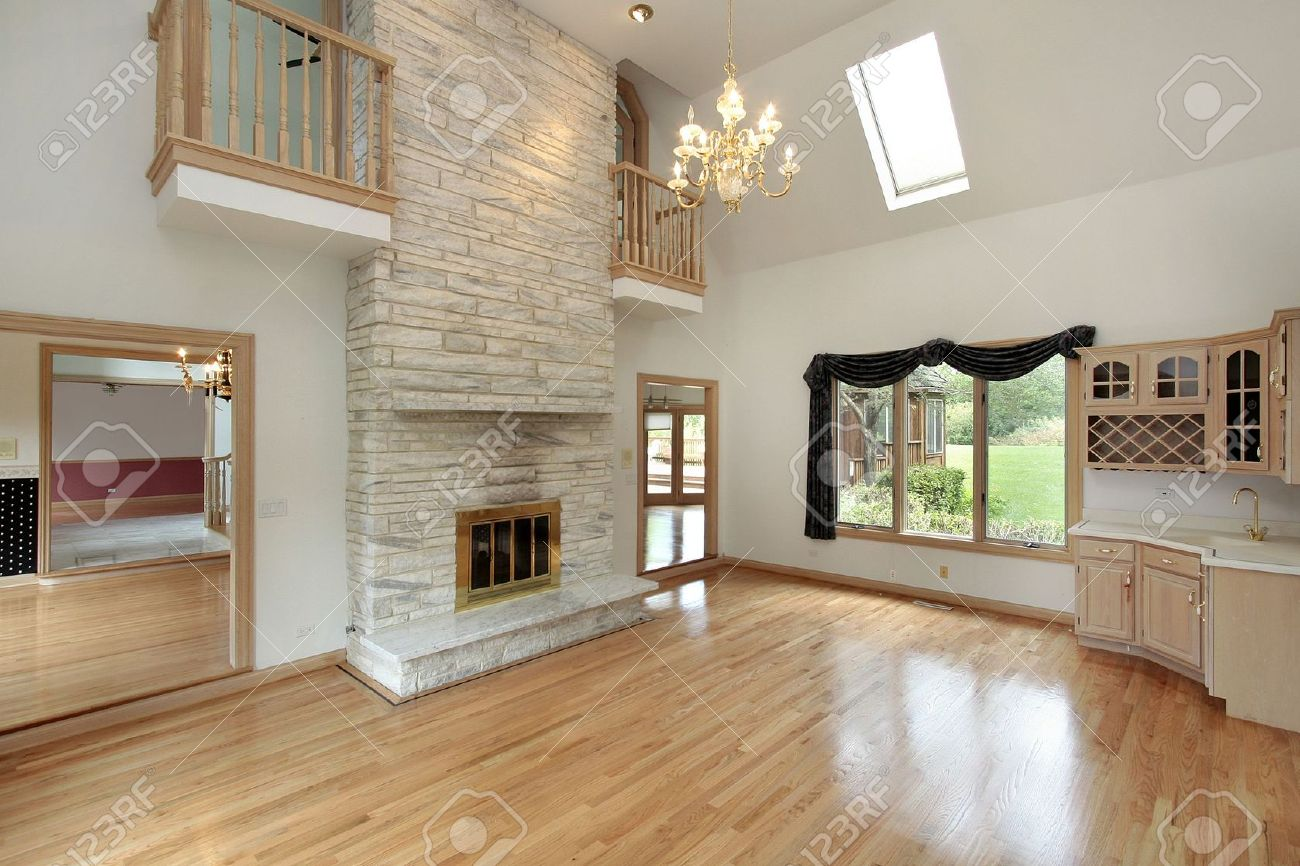 Living room in remodeled home with two story fireplace stock photo living room in remodeled home with two story fireplace stock photo 6738357 teraionfo