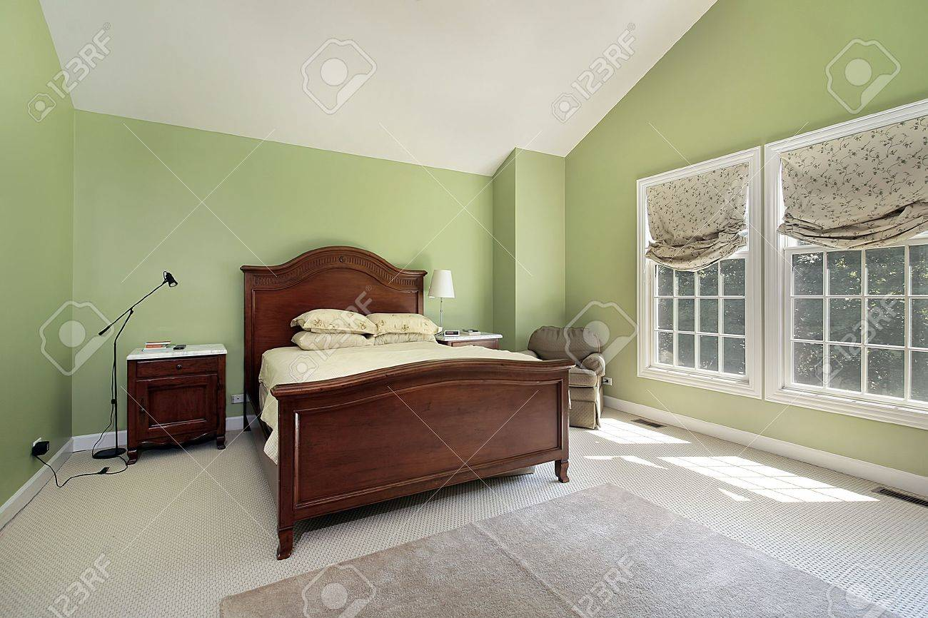 Master Bedroom Green Walls master bedroom in suburban home with green walls stock photo