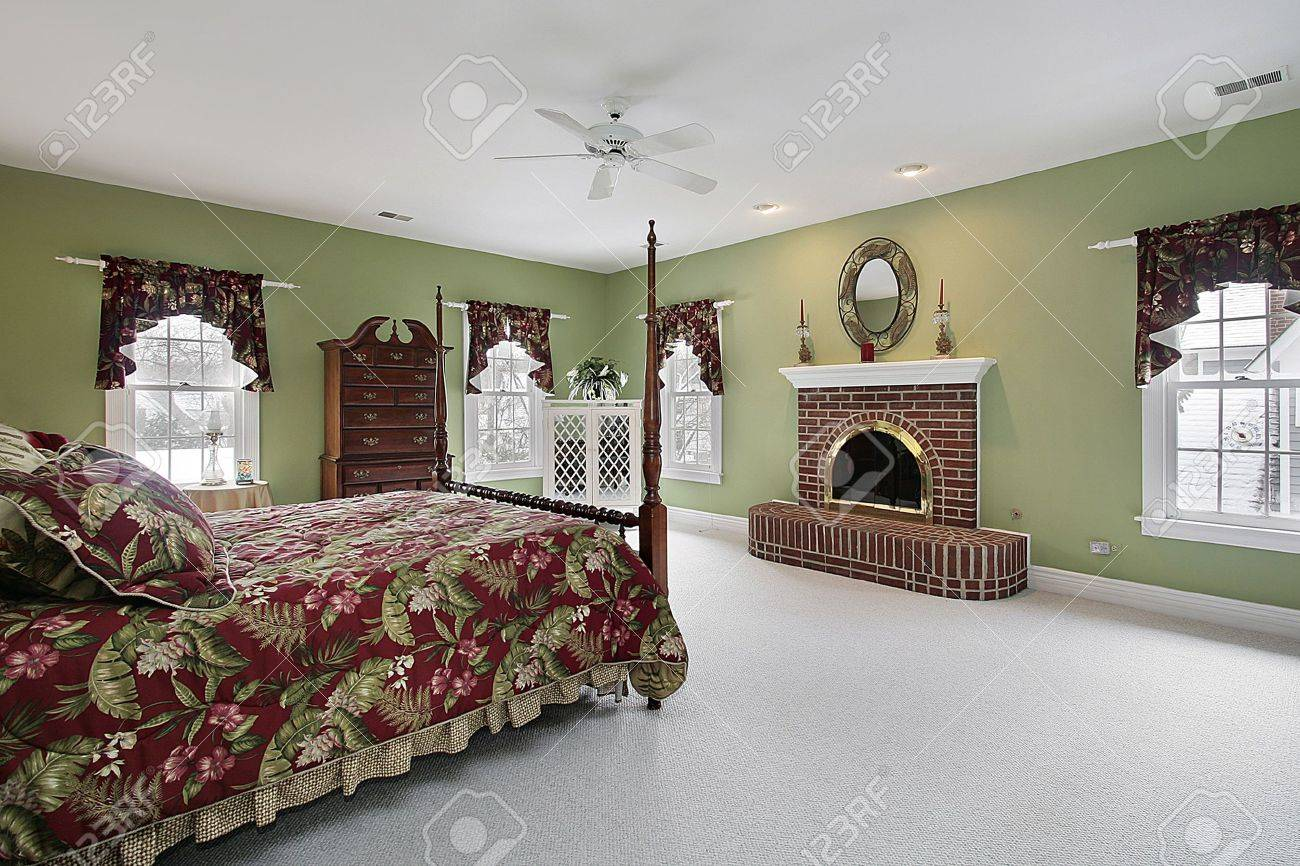 Master bedroom in suburban home with brick fireplace Stock Photo - 6739045
