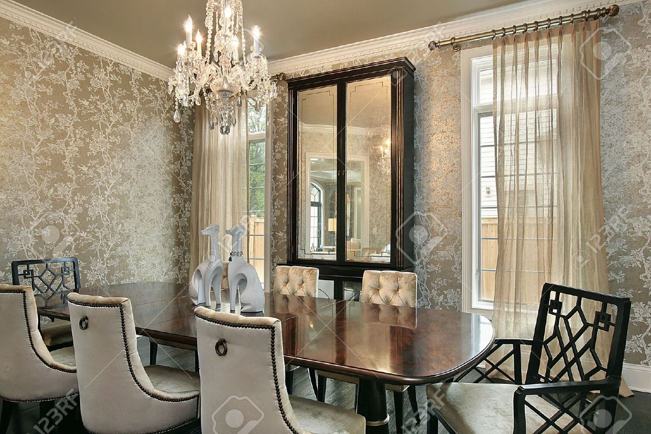 dining room in luxury home with gold walls stock photo picture and rh 123rf com