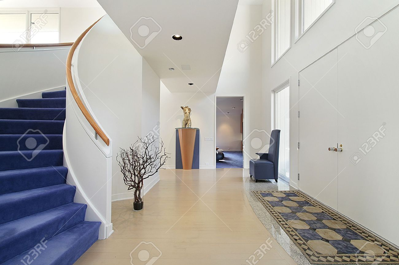 Foyer in luxury home with spiral staircase stock photo, picture ...