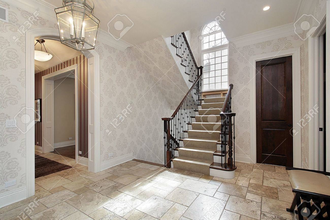Foyer in luxury home with second story window stock photo, picture ...