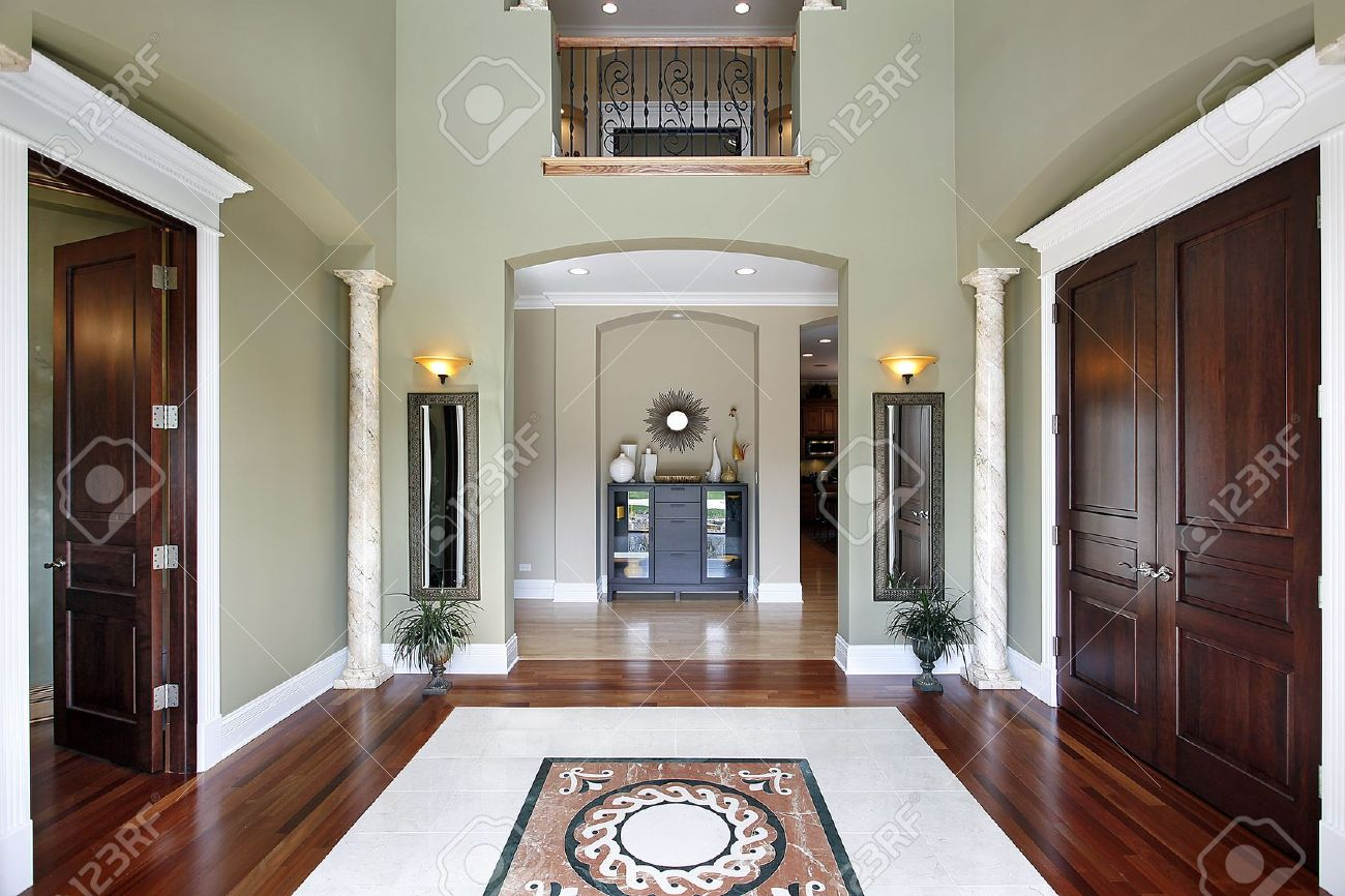 Luxury Homes Foyer foyer in luxury home with balcony and floor design stock photo