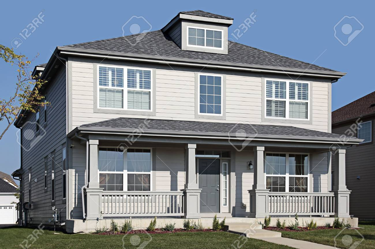 Gray home in suburbs with front porch Stock Photo - 6739278